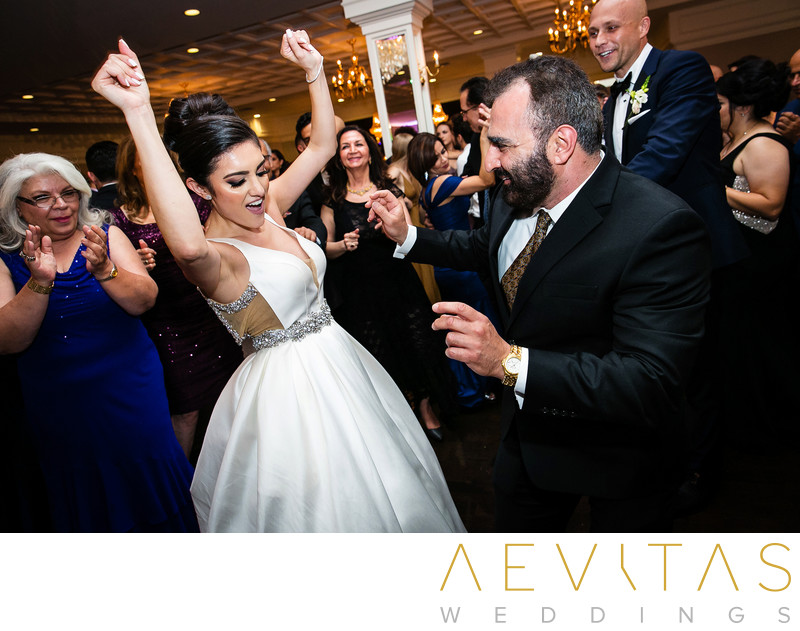 Bride dancing with arms in air at Sacramento wedding