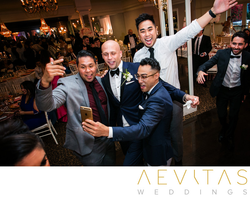 Guests taking selfie with groom at Arden Hills wedding