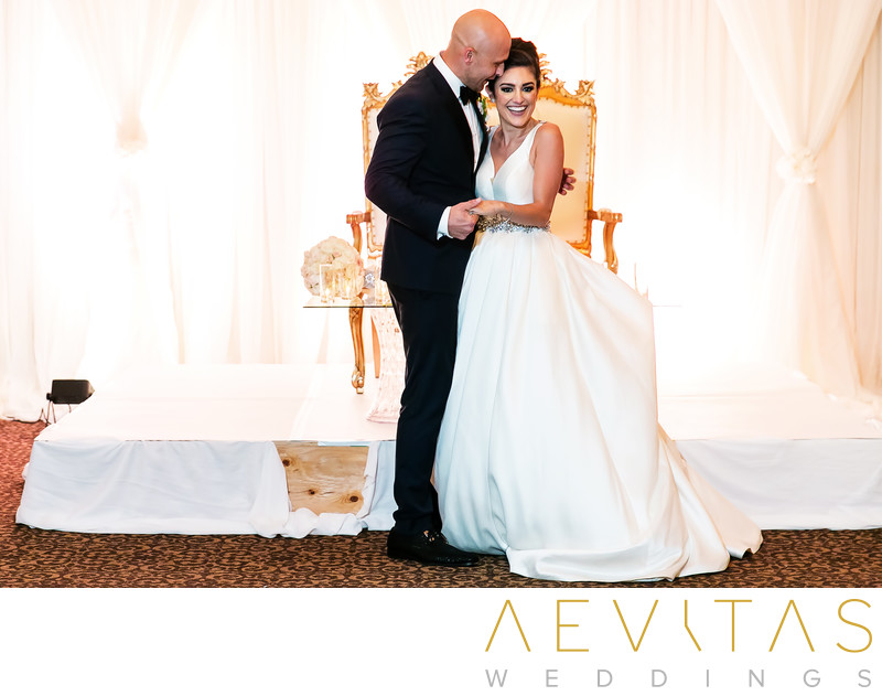 Couple embrace at Arden Hills Resort wedding reception