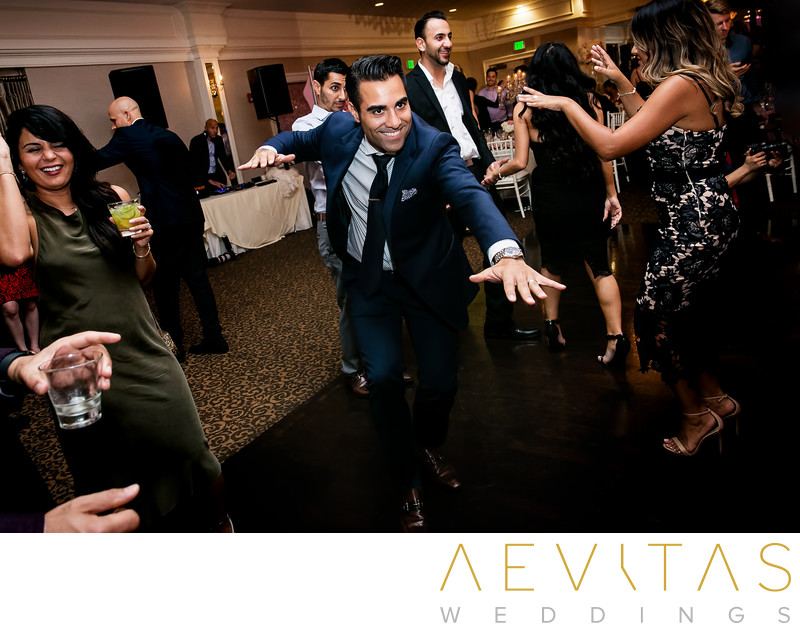 Funny wedding guest dancing action shot in Sacramento