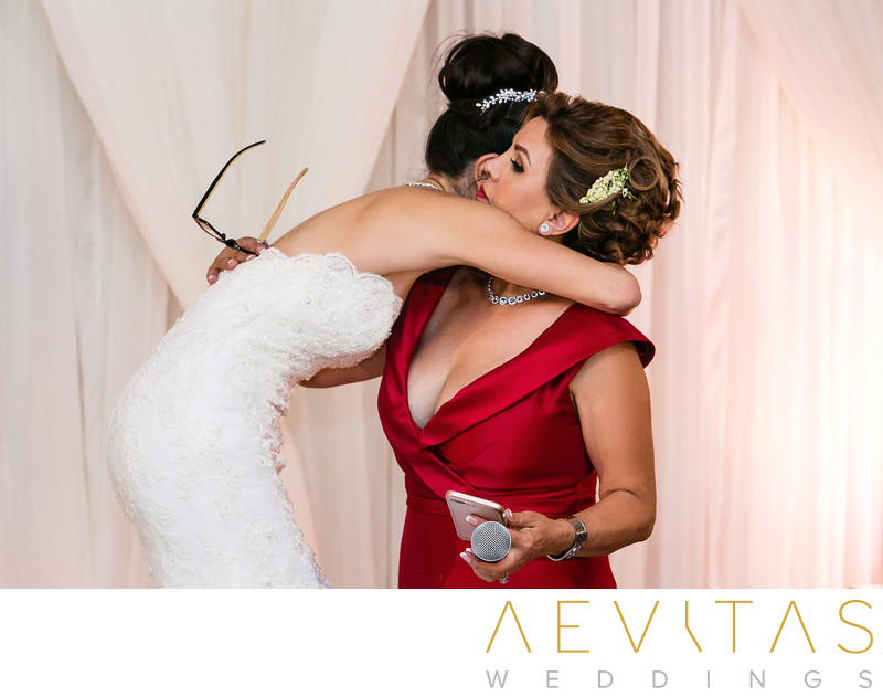 Bride embraces mom after Arden Hills reception speech
