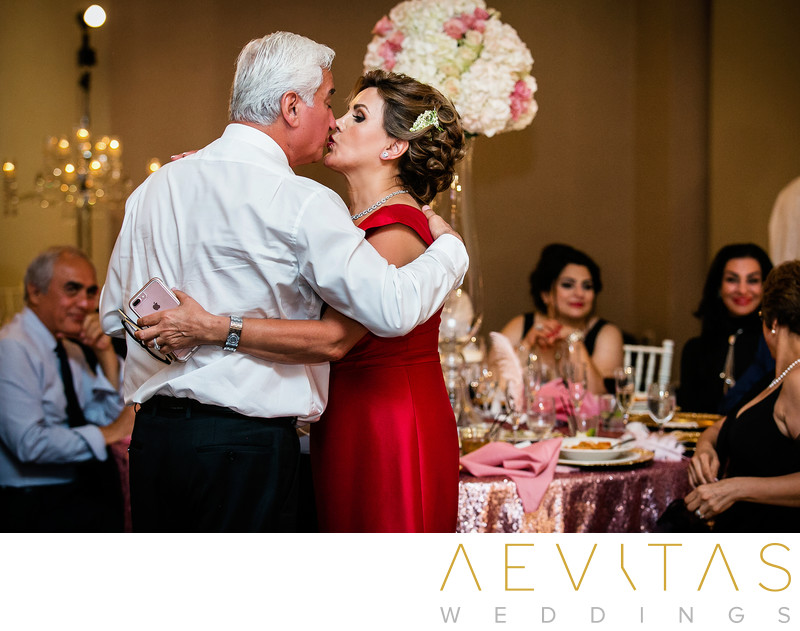 Parents-of-the-bride kiss at Arden Hills reception