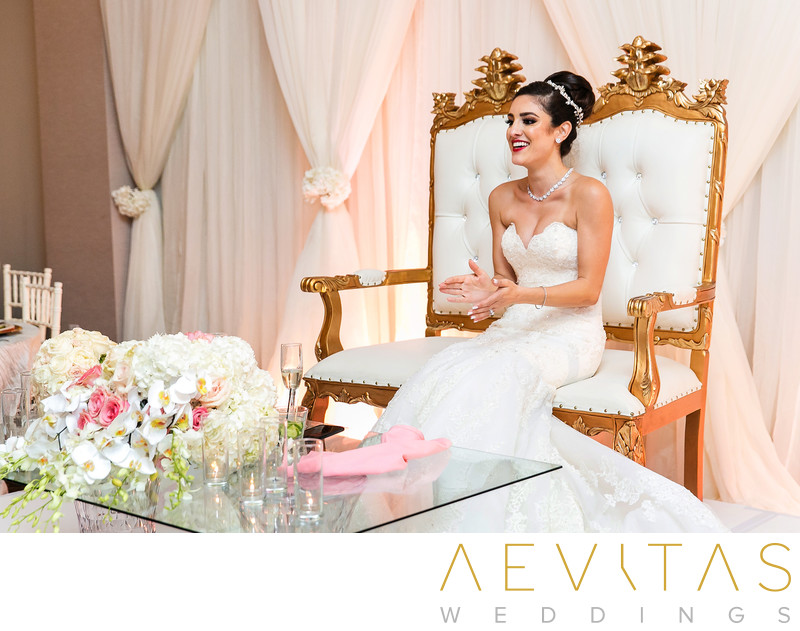 Bride clapping to dance at Arden Hills sweetheart sofa