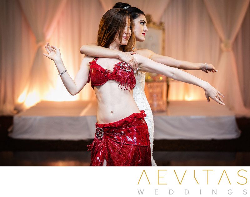 Bride and Persian dancer at Arden Hills reception