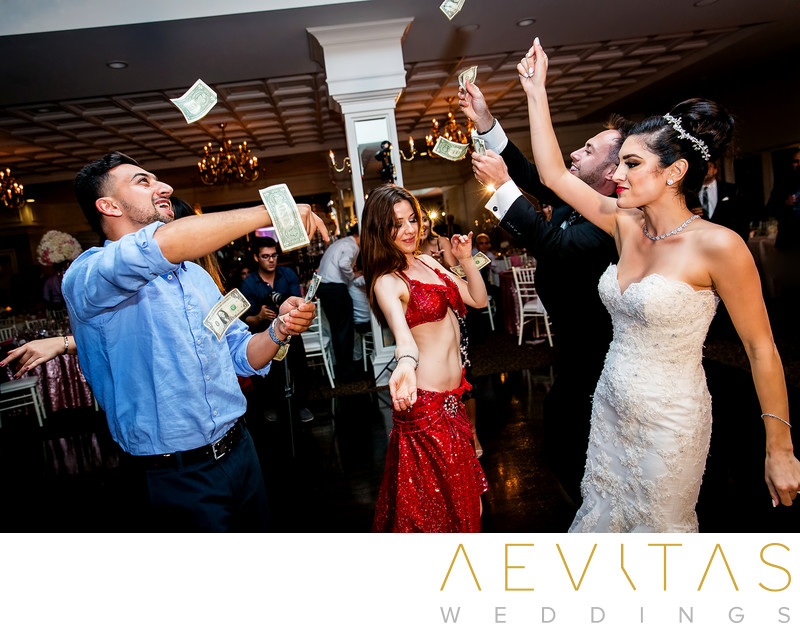 Guests throwing money at Persian wedding reception