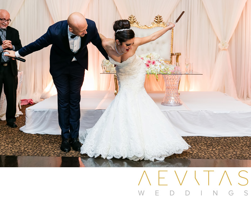 Bride and groom bow at Arden Hills wedding reception