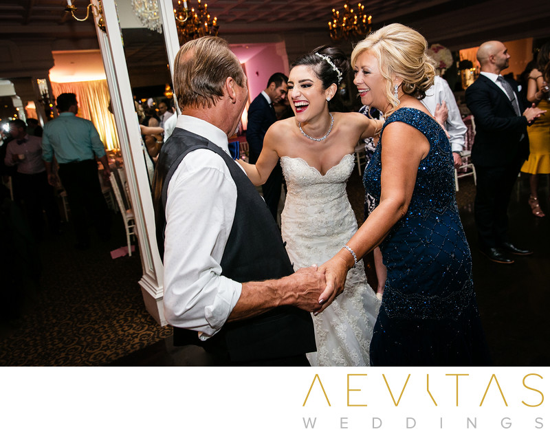 Bride laughing with parents-in-law Arden Hills wedding