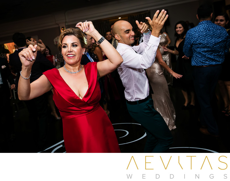 Mother and guest dancing at Arden Hills reception