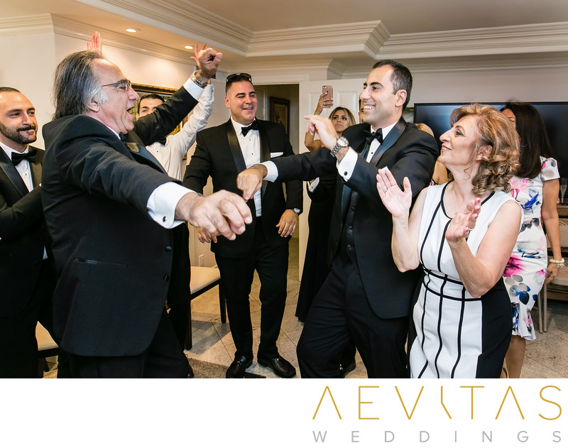 Groom dancing with dad at Armenian wedding party