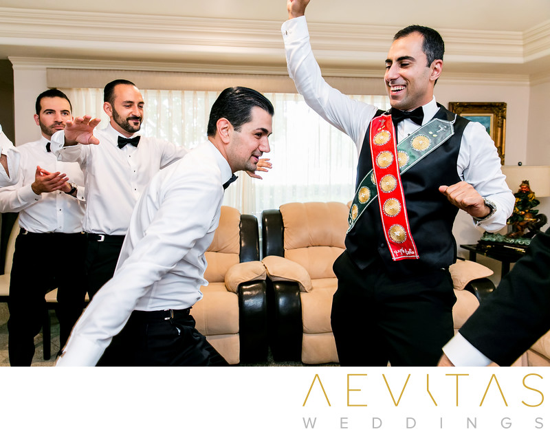 Groom and groomsmen dancing at Armenian getting ready