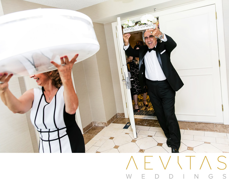 Parents carrying gifts at Armenian wedding party