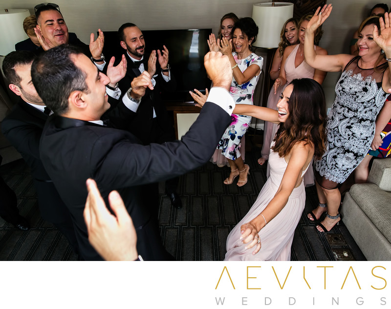 Groom dancing with women at Armenian wedding party