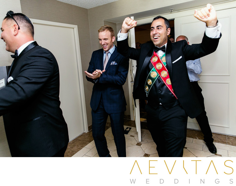 Groom enters room dancing at Armenian wedding party