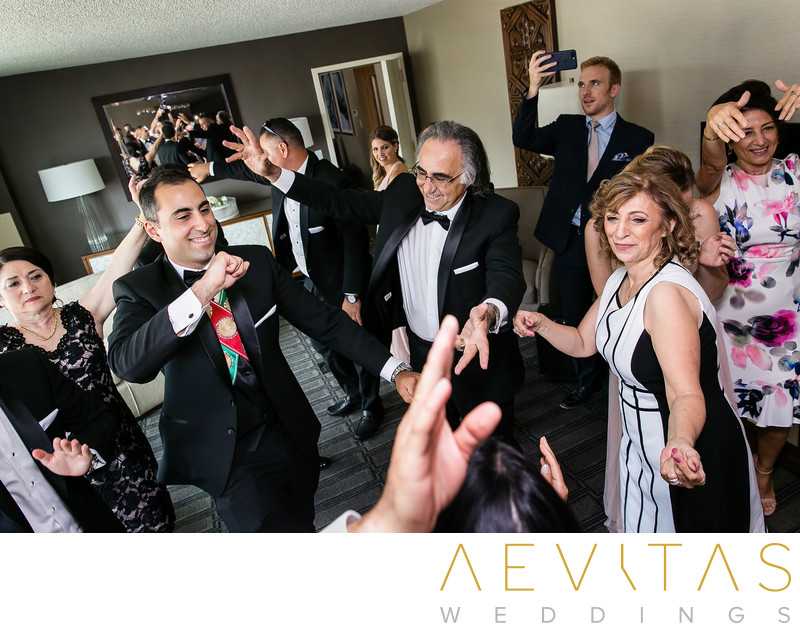 Creative photo of family dancing at Armenian wedding