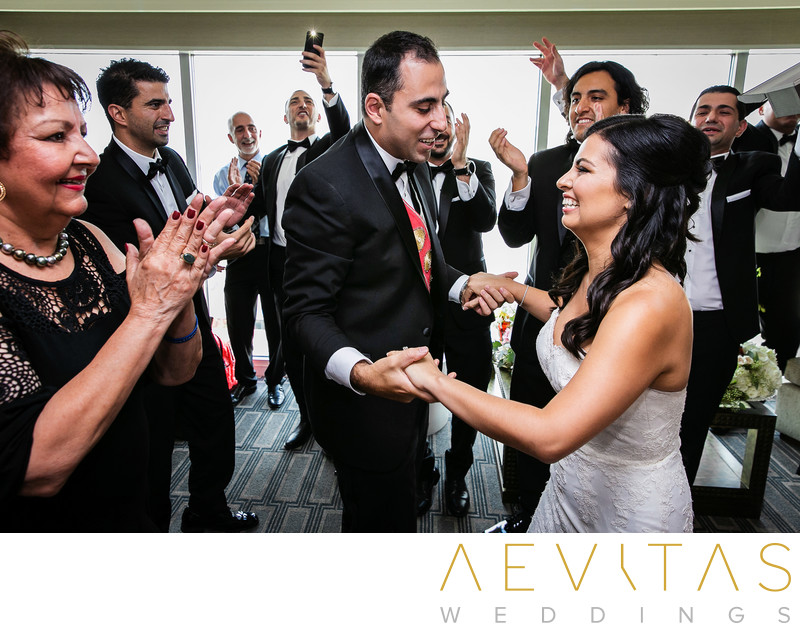 Bride and groom dancing at Armenian wedding party