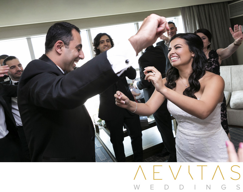 Couple dancing candid photo at Armenian wedding party