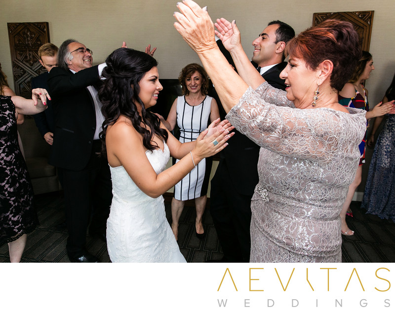 Mother and bride dancing at Armenian wedding party