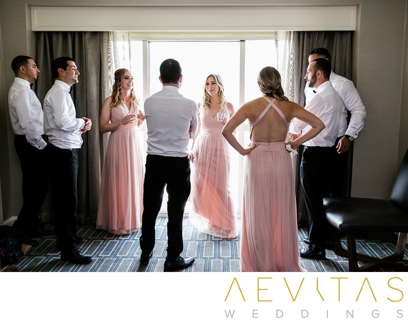 Candid moment between groomsman and bridesmaids in LA
