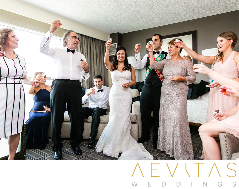 Couple and parents toast at Armenian wedding party