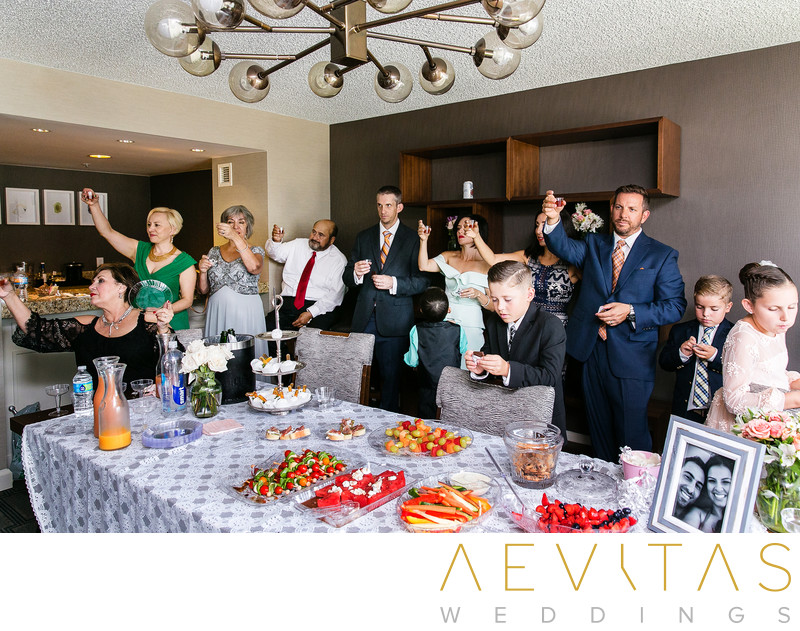 Guests toast beside table at Armenian wedding party