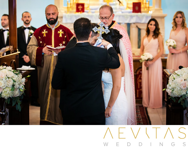 Cross placed at couple's heads at Armenian wedding