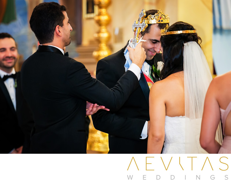 Couple wearing crowns with cross at Armenian wedding