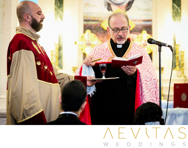 Priest reading bible at Armenian wedding ceremony