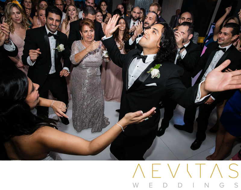 Brother dancing with bride at Armenian wedding party