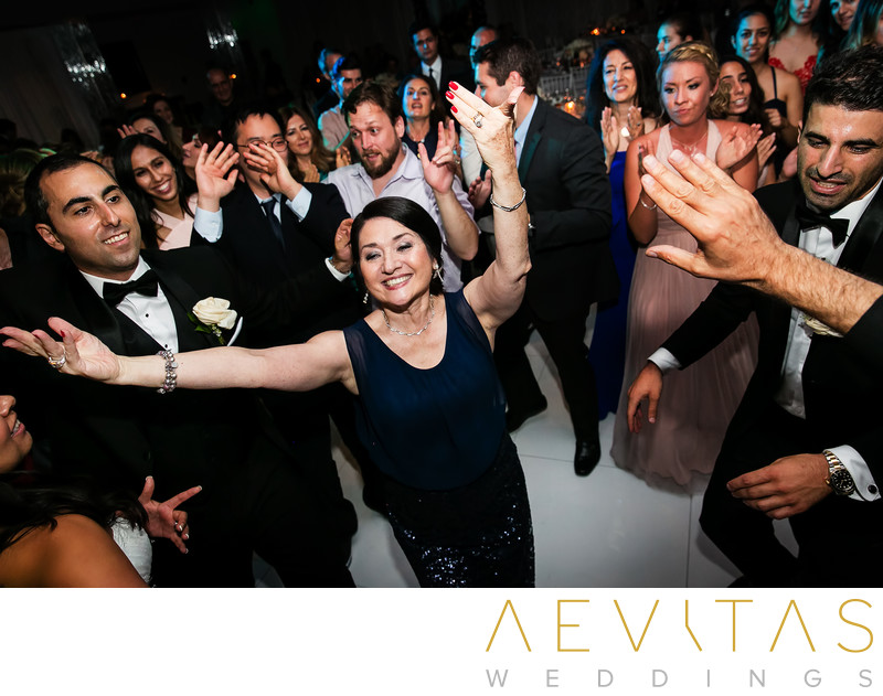 Woman dancing in circle at Vertigo Event Venue wedding