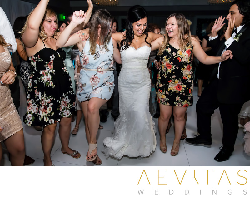 Bride dancing with women at Vertigo Event Venue