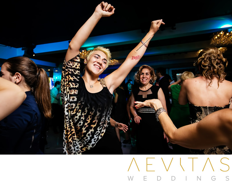 Wedding guest with arms in air at Vertigo in Glendale