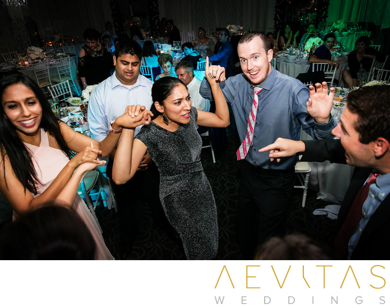 Wedding guests enjoying reception Vertigo Event Venue