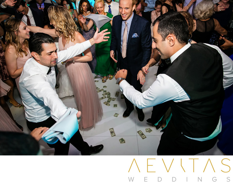 Groom dancing with friend at Armenian wedding reception