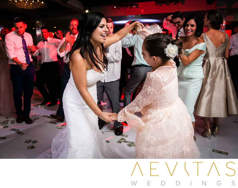 Bride dancing with flower girl at Vertigo Event Venue