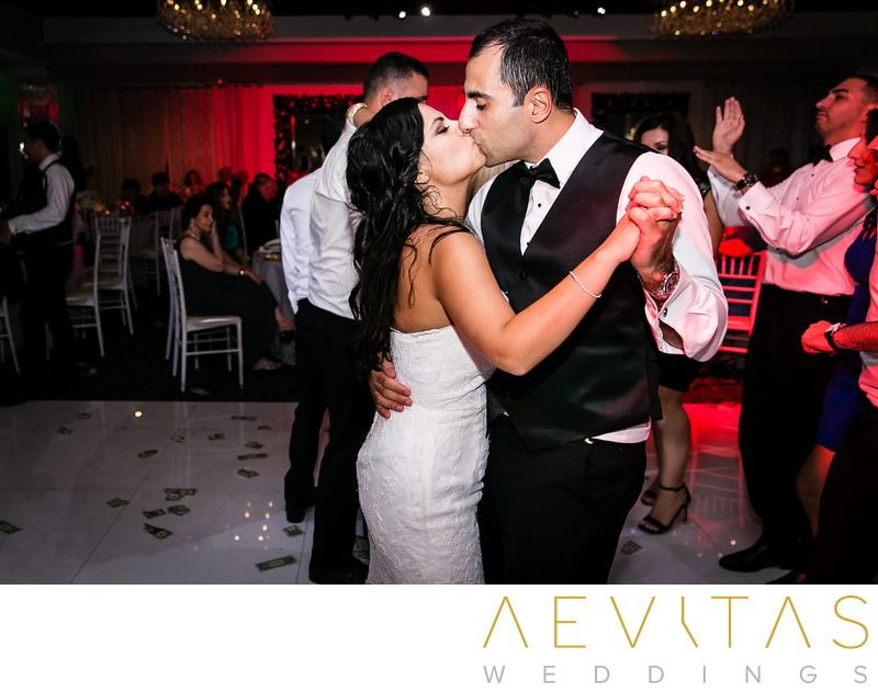 Couple kiss on dance floor at Vertigo Event Venue