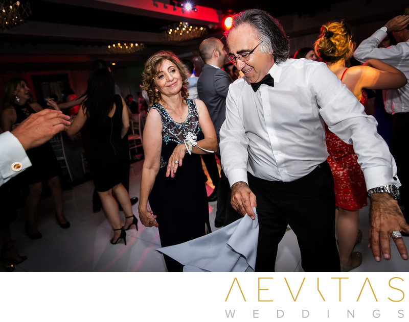 Parents of groom dancing at Armenian wedding reception