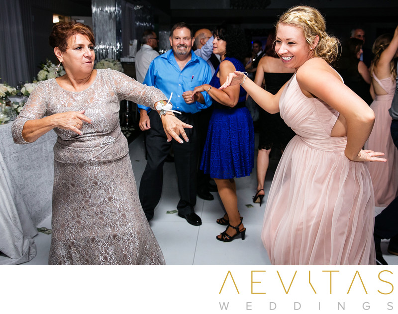 Mother and bridesmaid dancing at Vertigo Event Venue