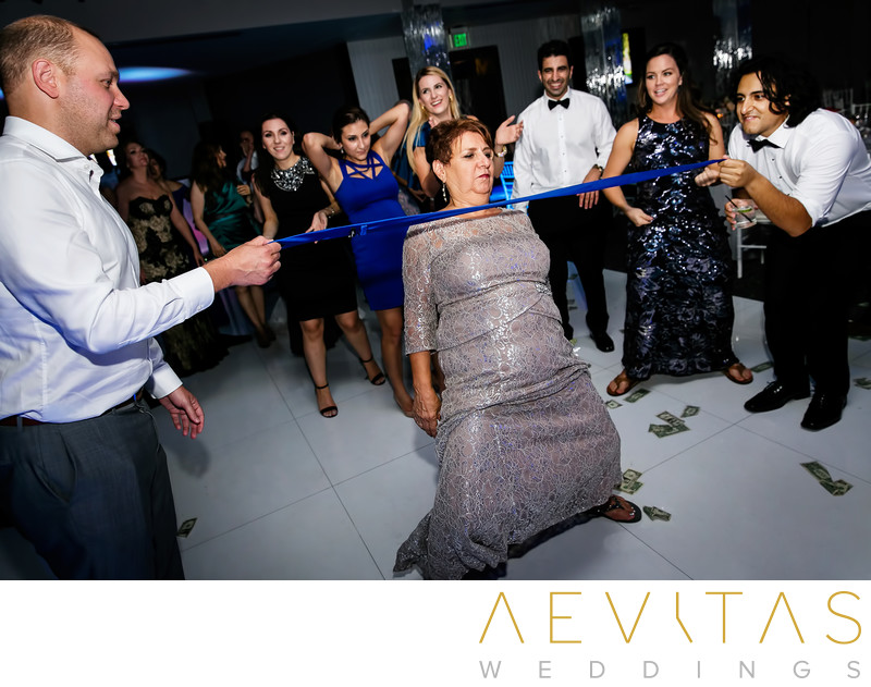 Mother doing limbo at Vertigo Event Venue reception