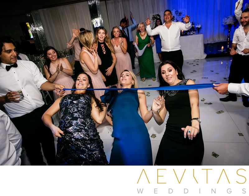 Three women doing limbo at Glendale wedding reception