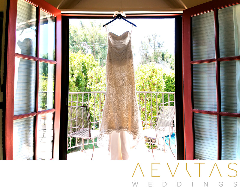 Wedding dress hanging in window at private LA residence