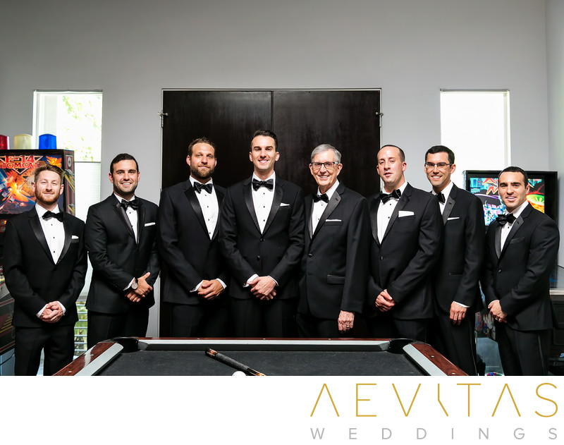 Groom and groomsmen portrait in private games room