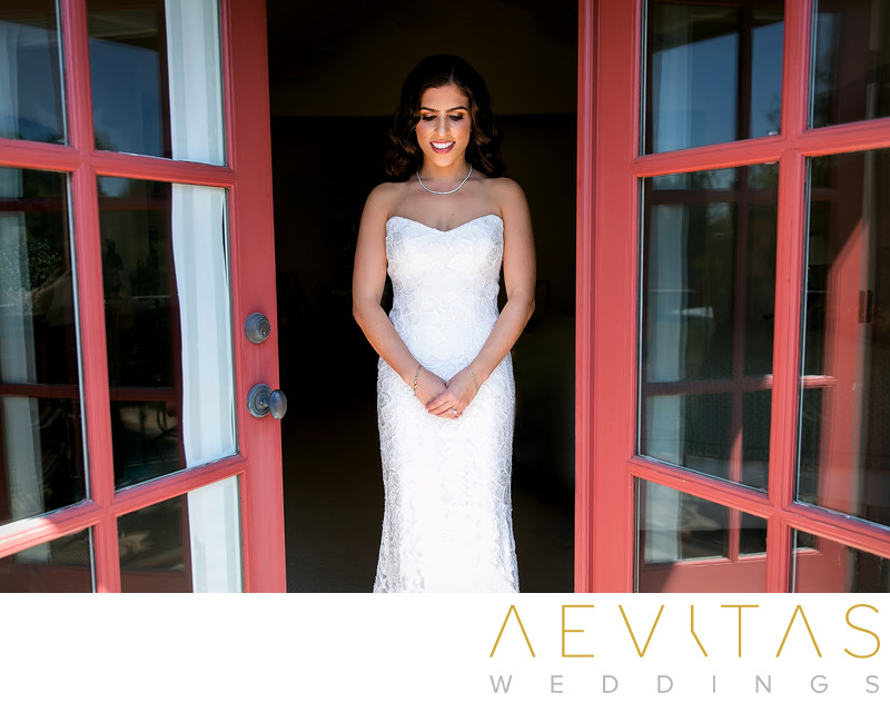 Bride portrait with red French doors at LA wedding