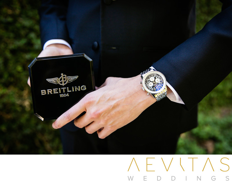 Close-up photo of groom's luxury watch by Breitling