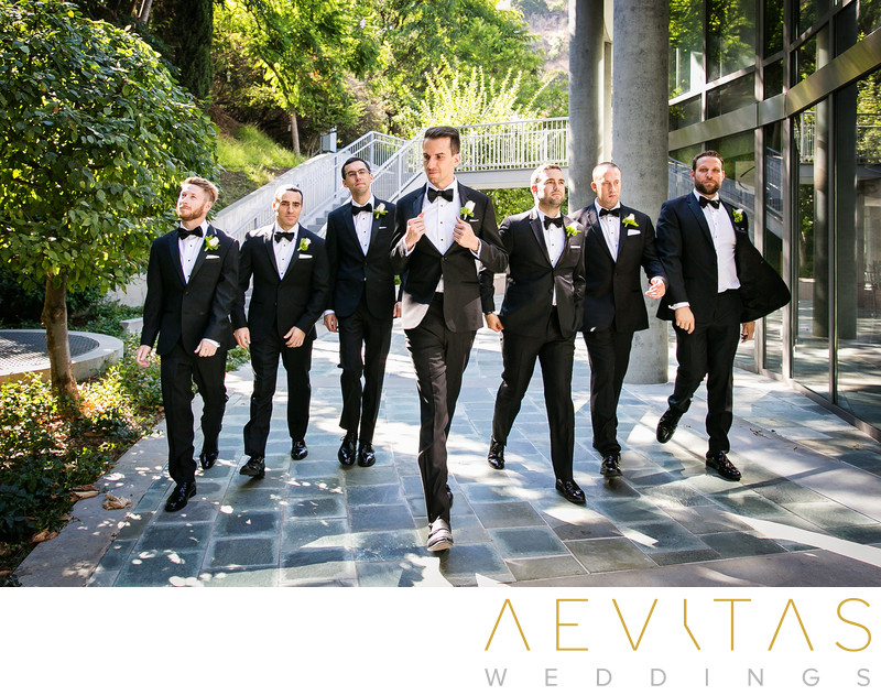 Groomsmen walking through Skirball Cultural Center