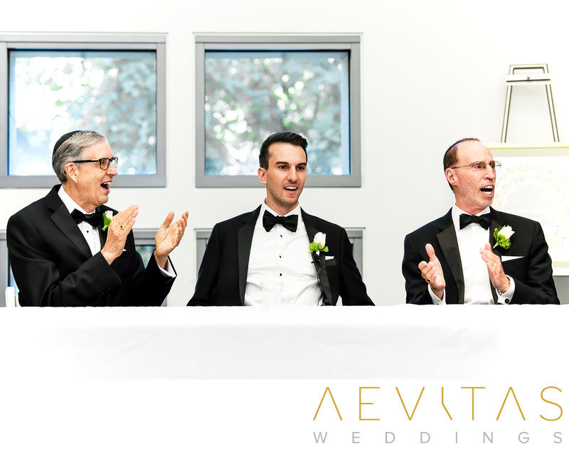Groom and fathers during Jewish Tish in Los Angeles