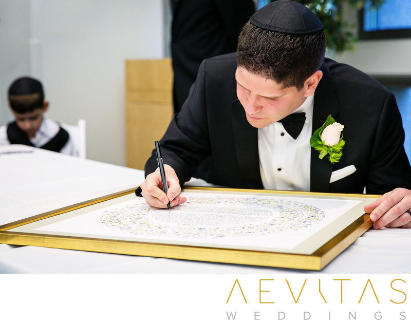 Signing Ketubah at Jewish Tish ceremony in Los Angeles