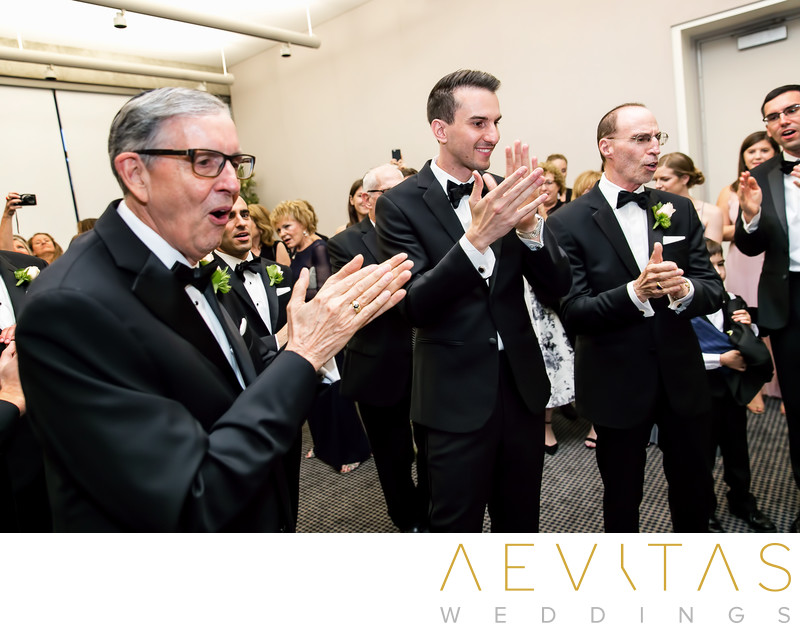 Groom and men clapping at Jewish Bedeken in Los Angeles