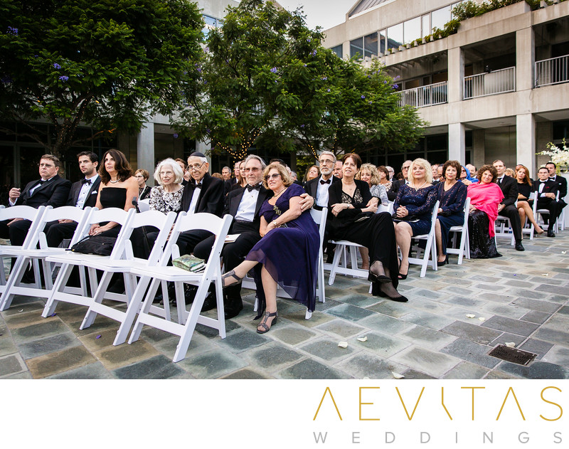 White chairs and guests at Skirball wedding ceremony