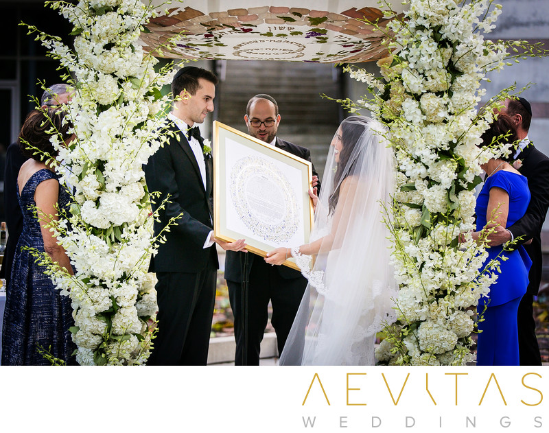 Couple hold Ketubah at Jewish wedding ceremony in LA
