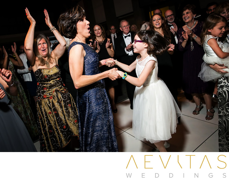 Mother and flower girl dancing at Skirball reception